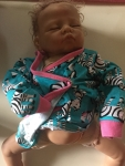 Babywearing Demo Doll - white, half bald with brown hair, sleeping, weighted with battery pack