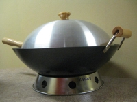 Wok with lid, stand, and steamer rack.