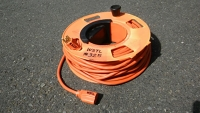 Extension cord, 100 ft orange with reel.