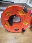 Extension Cord 100 ft with reel, Orange Cord with Black Stripe.