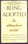 """Being Adopted: The Lifelong Search for Self"" by David Brodzinsky, Marshall Schechter, and Robin Hening"