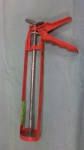 caulk gun (orange)
