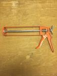 Orange Caulking gun