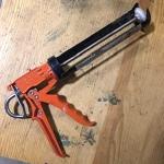 red caulking gun