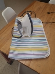 Iron and portable ironing pad