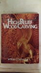 Book - High relief wood carving.