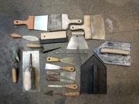 Lot d'outils de plâtrerie / enduits / ciment